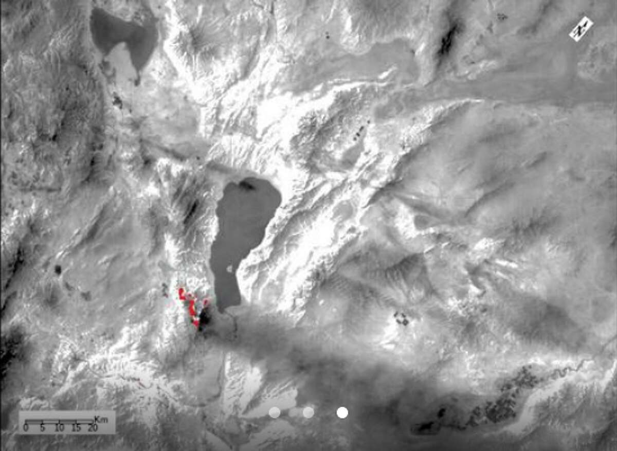 This zoomed-in ECOSTRESS image shows the Perry Fire burning in Nevada in red. Thick smoke plumes can also be seen rising from the fire.