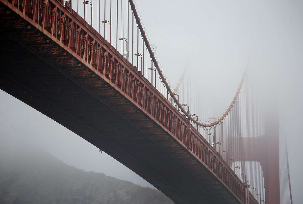 The towers of the Golden Gate Bridge are paritally obscured by fog in San Francisco, Calif. on Friday, Aug. 3, 2018. Construction on a new suicide deterrent barrier below the bridge's deck will begin soon.