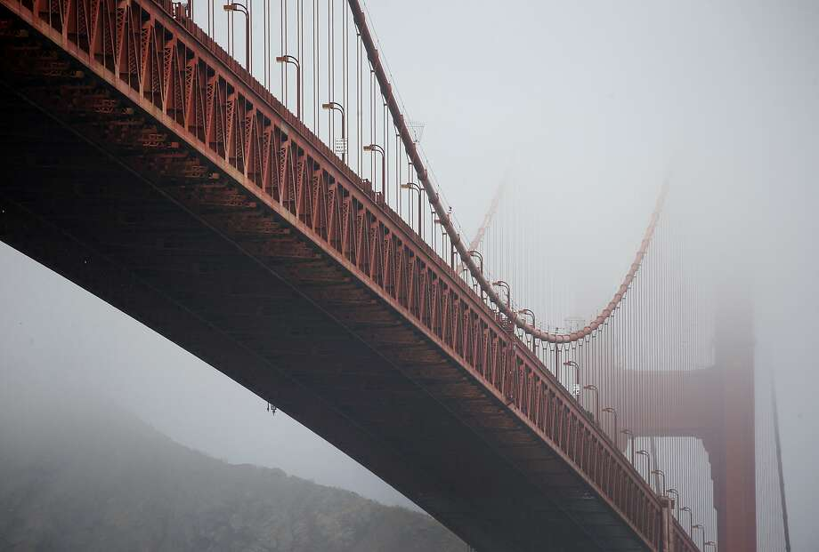 FILE -- The towers of the Golden Gate Bridge are partially obscured by fog in San Francisco, Calif. on Friday, Aug. 3, 2018.  Photo: Paul Chinn / The Chronicle