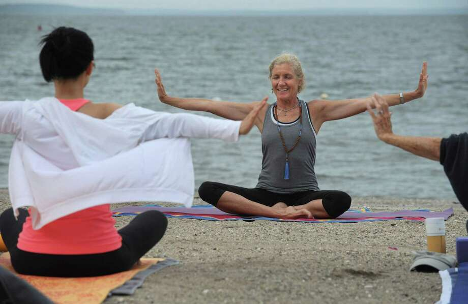 Martha Risom teaches Community Yoga at Bayley Beach, in their 6th season, Saturday, August 4, 2018, in Rowayton, Conn. The classes, sponsored by the Sixth Taxing District, begin Memorial Day Weekend each year and run through September 30. Weekend classes start at 8am. Thursday classes start at 9:15am. Photo: Erik Trautmann / Hearst Connecticut Media / Norwalk Hour