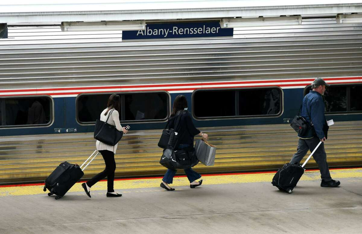 Rail passengers board a New York bound train at Albany-Rensselaer Train Station on Wednesday, May 24, 2017, in Rensselaer, N.Y. (Will Waldron/Times Union)