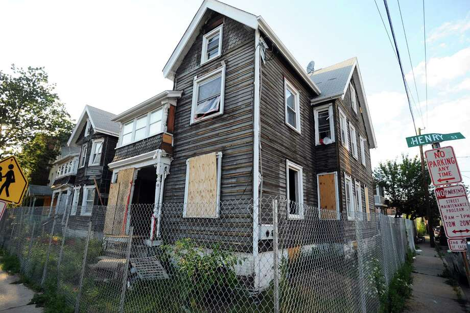 Several Building and Land Technology-owned houses on the corner of Henry Street and Garden streets were reported last week as blighted. Photo: Michael Cummo / Hearst Connecticut Media / Stamford Advocate