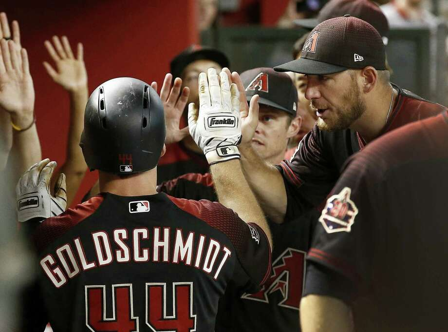 Paul Goldschmidt, left, celebrates his home run against the San Francisco Giants with teammates, including Jeff Mathis, right, during the first inning of a baseball game Friday. Photo: Ross D. Franklin, STF / Associated Press / Copyright 2018 The Associated Press. All rights reserved.