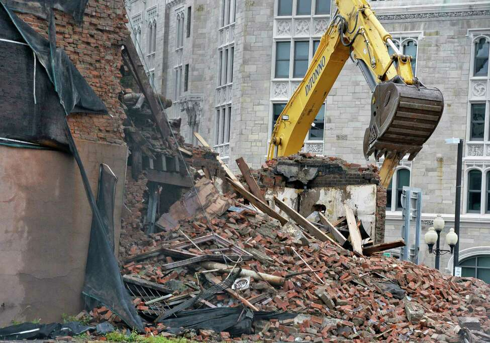Demolition of Six E-Comm Square continues Saturday August 4, 2018 in Albany, NY. (John Carl D'Annibale/Times Union)