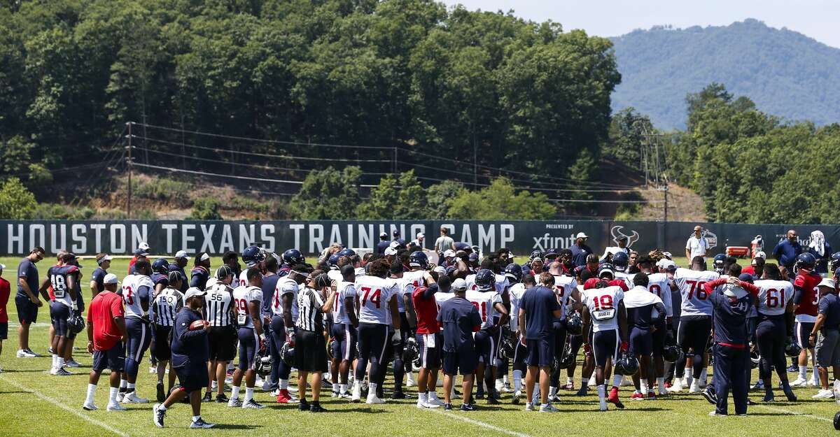 The Houston Texans gather in a huddle at the end of practice during training camp at the Greenbrier Sports Performance Center on Saturday, Aug. 4, 2018, in White Sulphur Springs, W.Va.