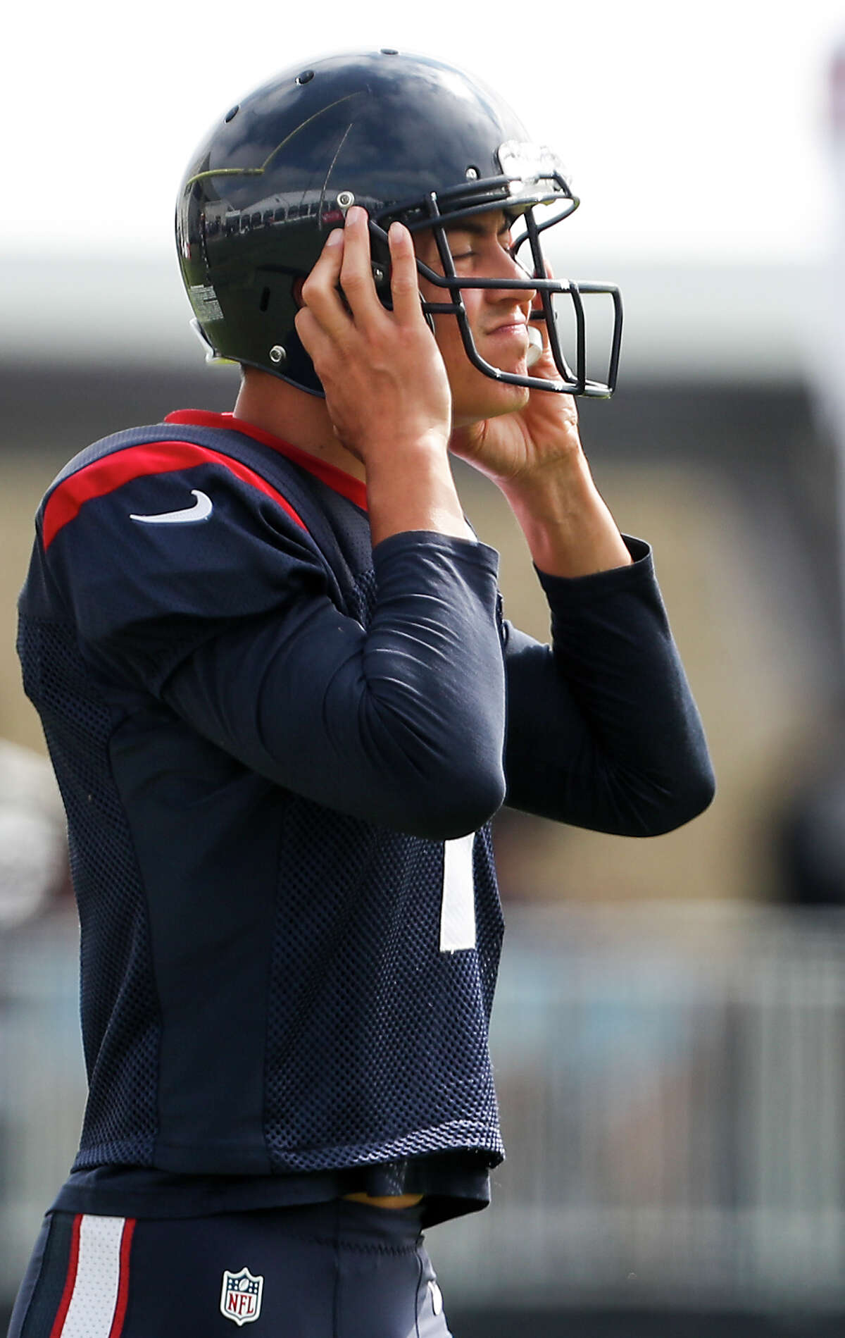 Houston Texans kicker Ka'imi Fairbairn dons his helmet as he walks onto the practice field during training camp at the Greenbrier Sports Performance Center on Saturday, Aug. 4, 2018, in White Sulphur Springs, W.Va.