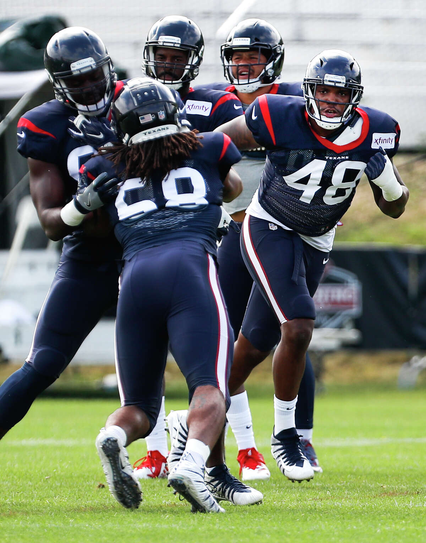 Houston Texans linebacker Davin Bellamy (48) runs a drill against linebacker Peter Kalambayi (58) during training camp at the Greenbrier Sports Performance Center on Saturday, Aug. 4, 2018, in White Sulphur Springs, W.Va.