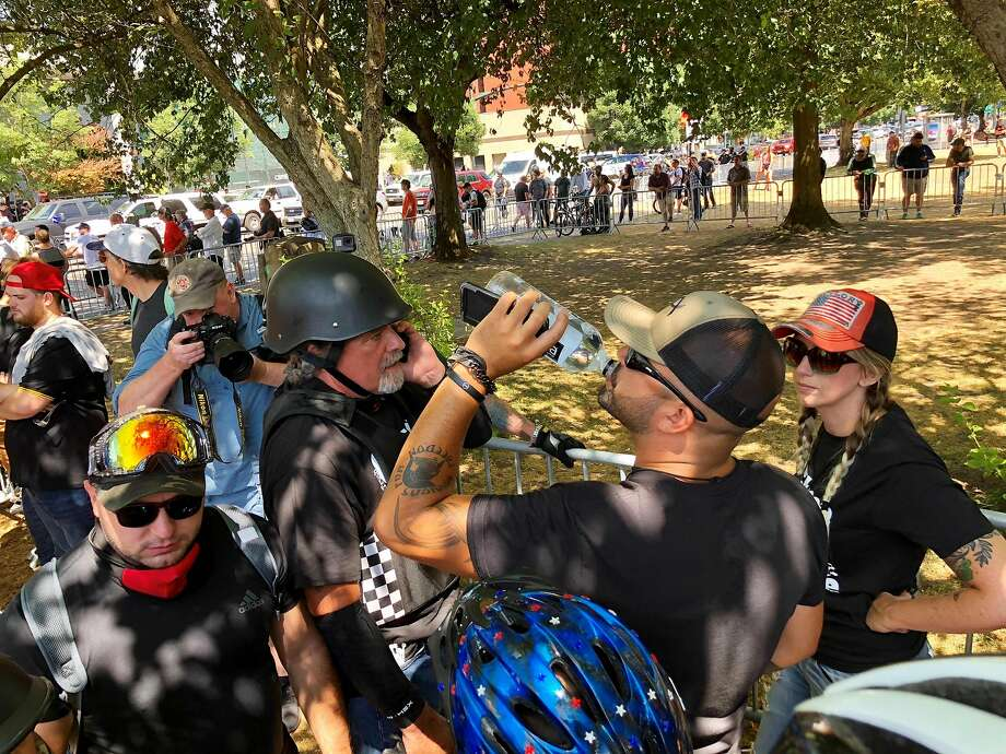"Rally leader and US Senate candidate Joey Gibson drinks water as people gather for a demonstration by two far-right groups on August 4, 2018 in Portland, Oregon.  Police in Portland, Oregon braced for violence at the rally that has raised fears of a replay of last year's deadly ""Unite the Right"" protests in Charlottesville, Virginia. Patriot Prayer and the Proud Boys, right-wing groups linked to violence at a previous Portland rally, planned to march in the city's Tom McCall Waterfront Park in support of Patriot Prayer founder Joey Gibson, who is running as a Republican for the US Senate. Meanwhile, a group called Popular Mobilization is organizing a counter-demonstration at the park, accompanied by a marching band and protesters in clown costumes.  / AFP PHOTO / Thomas PATTERSONTHOMAS PATTERSON/AFP/Getty Images Photo: THOMAS PATTERSON;Thomas Patterson / AFP / Getty Images"