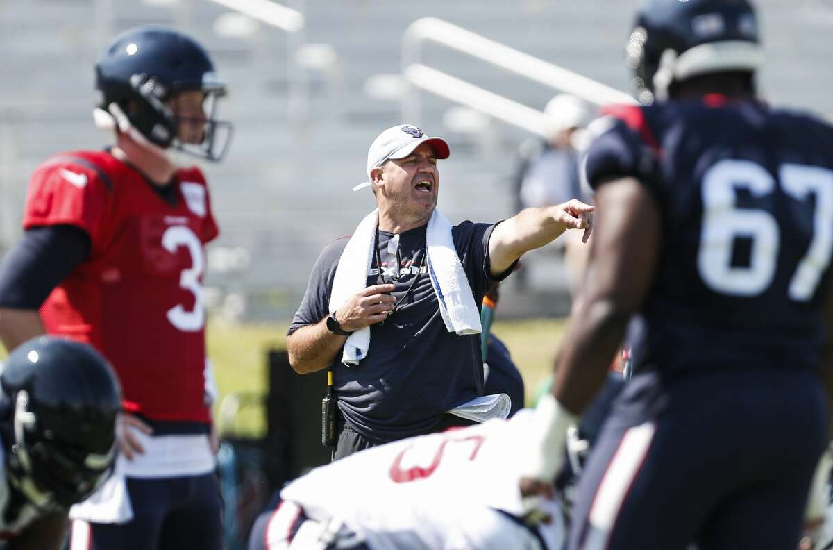 Houston Texans head coach Bill O'Brien makes a call from behind the offense during training camp at the Greenbrier Sports Performance Center on Saturday, Aug. 4, 2018, in White Sulphur Springs, W.Va.