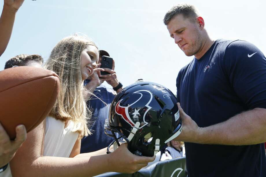 Houston Texans defensive end J.J. Watt signs autographs during training camp at the Greenbrier Sports Performance Center on Saturday, Aug. 4, 2018, in White Sulphur Springs, W.Va. Photo: Brett Coomer/Houston Chronicle