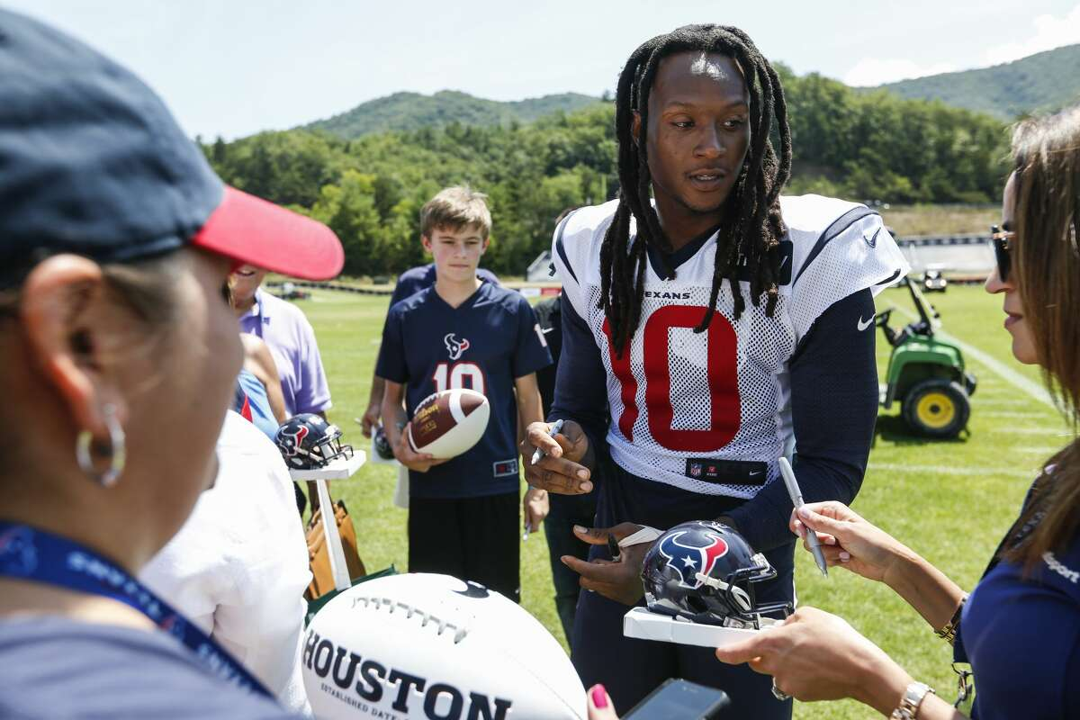 PHOTOS: Current NFL players from Houston Houston Texans wide receiver DeAndre Hopkins (10) signs autographs during training camp at the Greenbrier Sports Performance Center on Saturday, Aug. 4, 2018, in White Sulphur Springs, W.Va. >>>Browse through the photos for a look at current NFL rosters and which players come from Houston ...