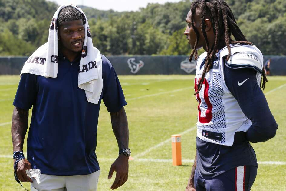 Former Houston Texans wide receiver Andre Johnson, left, talks to Texans wide receiver DeAndre Hopkins (10) after practice during training camp at The Greenbrier Sports Performance Center on Saturday, Aug. 4, 2018, in White Sulphur Springs, W.Va.