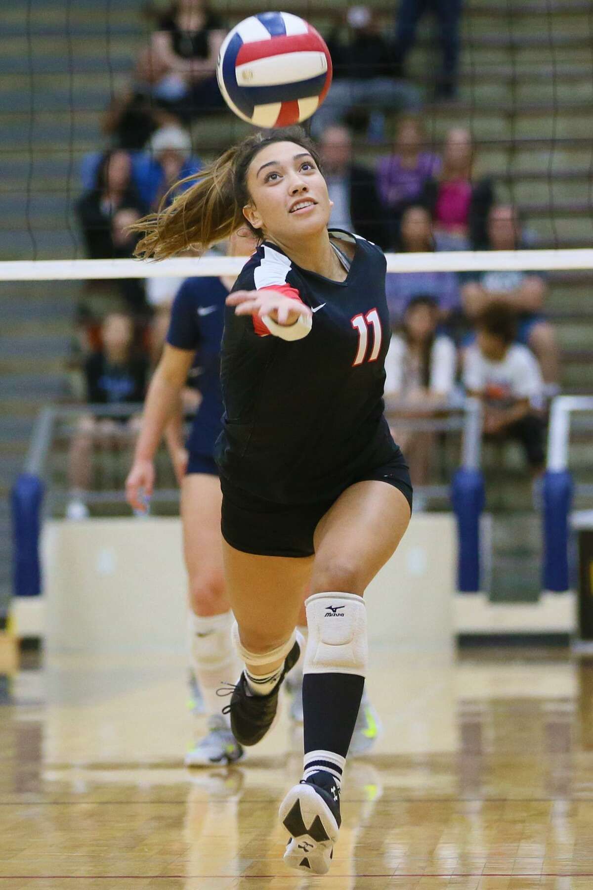 Churchill's Lourdes Gomez chases down a ball during their Class 6A third-round high school volleyball playoff match with O'Connor at the Alamo Convocation Center on Tuesday, Nov. 7, 2017. O'Connor won in five sets: 25-20, 25-27, 25-23, 25-27, 15-6. MARVIN PFEIFFER/mpfeiffer@express-news.net
