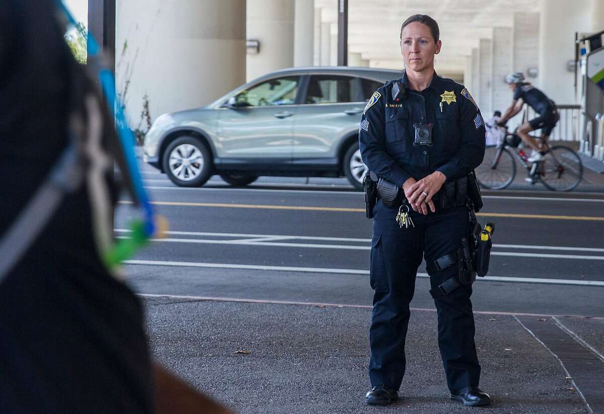 Bart police officers patrol Rockridge Bart station in Oakland on Aug. 4, 2018.