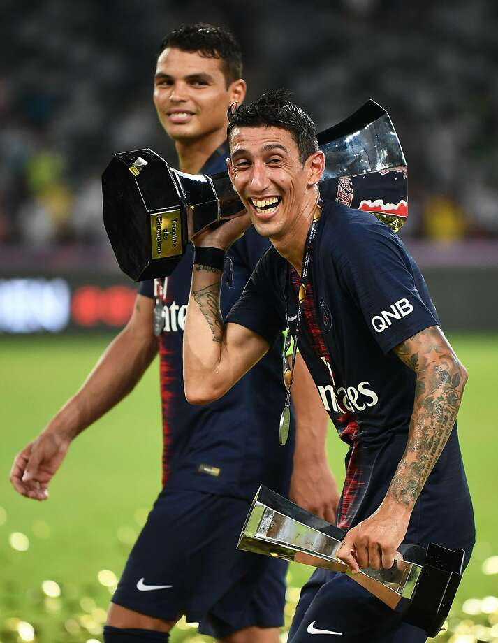 Paris Saint-Germain's Angel Di Maria, who scored two goals, hoists the French Super Cup after PSG beat Monaco 4-0. Photo: Anne-Christine Poujoulat / AFP / Getty Images