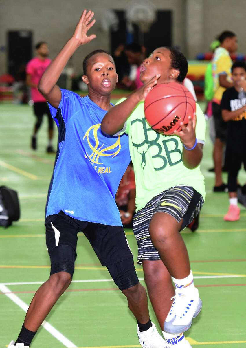 Hason Green (left), 12, of Soul 4 Real covers Ani Washington, 11, of the Ballers Crew during the CT Big 3 Ballout at the Floyd Little Athletic Center in New Haven on August 4, 2018. Two hundred and forty athletes on 60 teams from Connecticut, Pennsylvania and New Jersey competed during two days of three on three basketball games.
