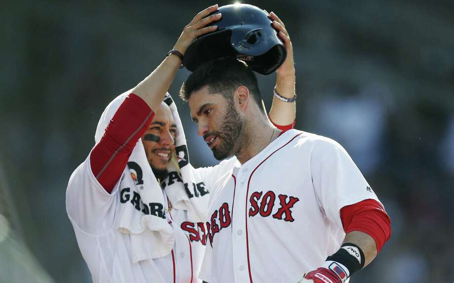 Mookie Betts, left, and J.D. Martinez have been a potent 1-2 punch for the Red Sox this season. Photo: Michael Dwyer / Associated Press / Copyright 2018 The Associated Press. All rights reserved