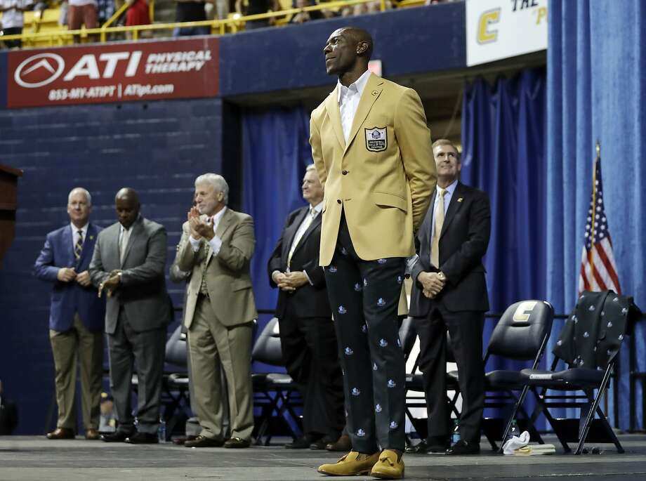 Former wide receiver Terrell Owens is applauded after he was given his Pro Football Hall of Fame coat on Saturday, Aug. 4, 2018, in Chattanooga, Tenn. Instead of speaking at the Hall of Fame festivities in Canton, Ohio, Owens celebrated his induction at the University of Tennessee at Chattanooga, where he played football and basketball and ran track. (AP Photo/Mark Humphrey) Photo: Mark Humphrey, Associated Press