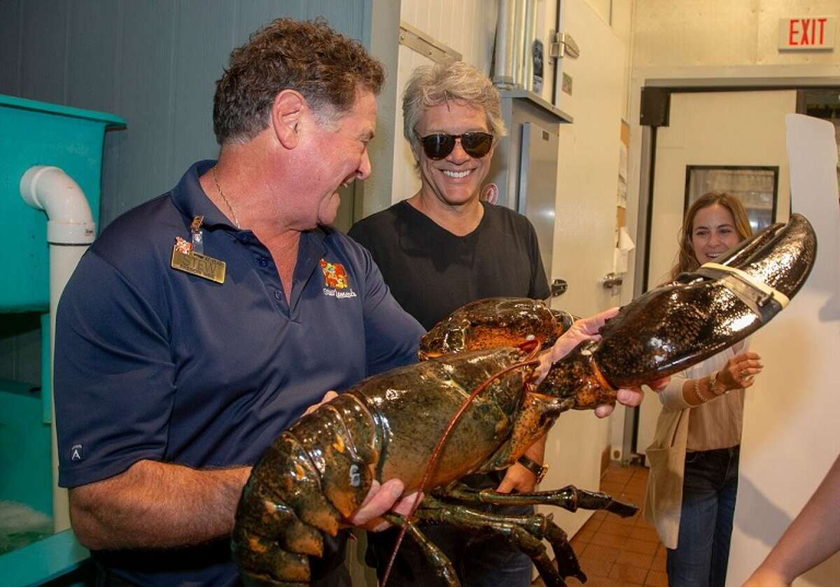 Stew Leonard Jr., left, presents Jon Bon Jovi with a 20-pound lobster. Rocker Jon Bon Jovi made a surprise visit to a Stew Leonard's supermarket recently to support a family business venture and to collect some special groceries.