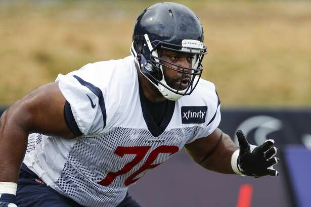 Houston Texans offensive tackle Seantrel Henderson (76) runs through a drill during training camp at the Greenbrier Sports Performance Center on Thursday, Aug. 2, 2018, in White Sulphur Springs, W.Va.