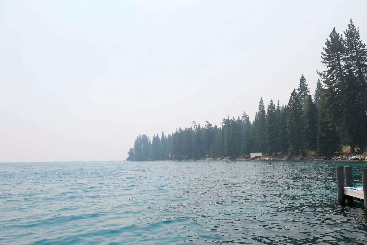 A haze of smoke obscures the pine trees in Sugar Pine Point State Park in South Lake Tahoe on Saturday, August 4th 2018. Photo by Cahner Olson.