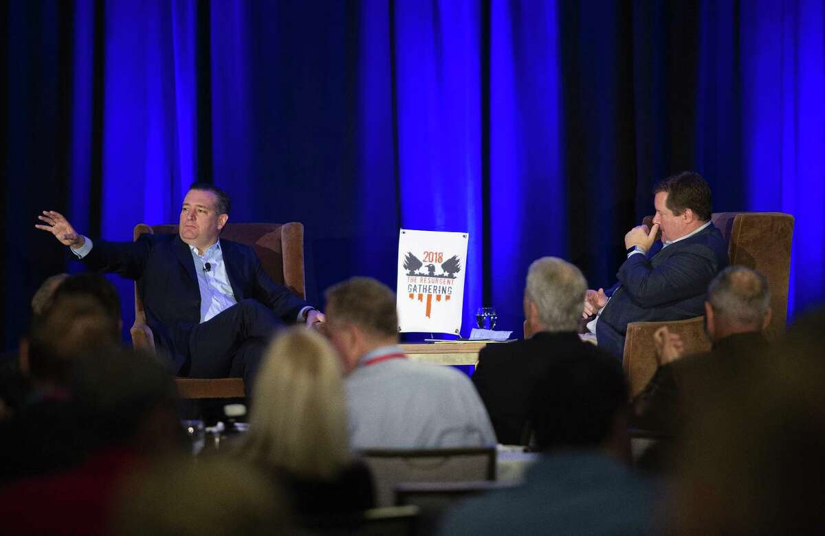 Senator Ted Cruz speaks to the crowd while host Erick Erickson listens at a Republican event called The Resurgent Gathering at the Capitol Sheraton hotel in Austin, Texas on August 4, 2018.