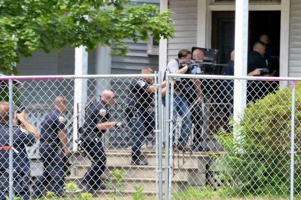 Heavily armed police enter 1373 Union Street following the report of a shooting Tuesday July 10, 2018 in Schenectady, NY. (John Carl D'Annibale/Times Union)