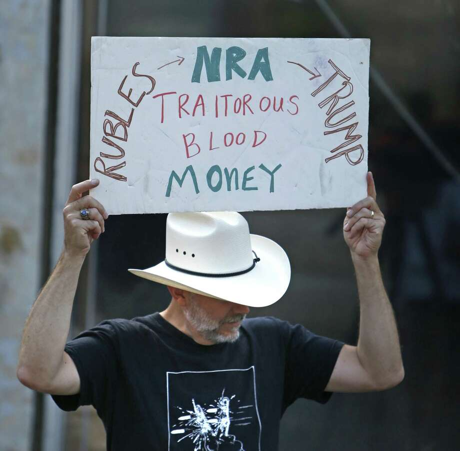 """7Andrew Morosky holds his sign as he listens to speakers at beginning of march. Students will be marching downtown as part of the """"March On NRA San Antonio,"""" one of several such events happening that day around the country. The event will include speakers and visits to the offices of politicians who have """"A"""" ratings from the NRA on Saturday, Aug.4, 2018. Photo: Ronald Cortes, Photo Correspondent / 2018 Ronald Cortes"""