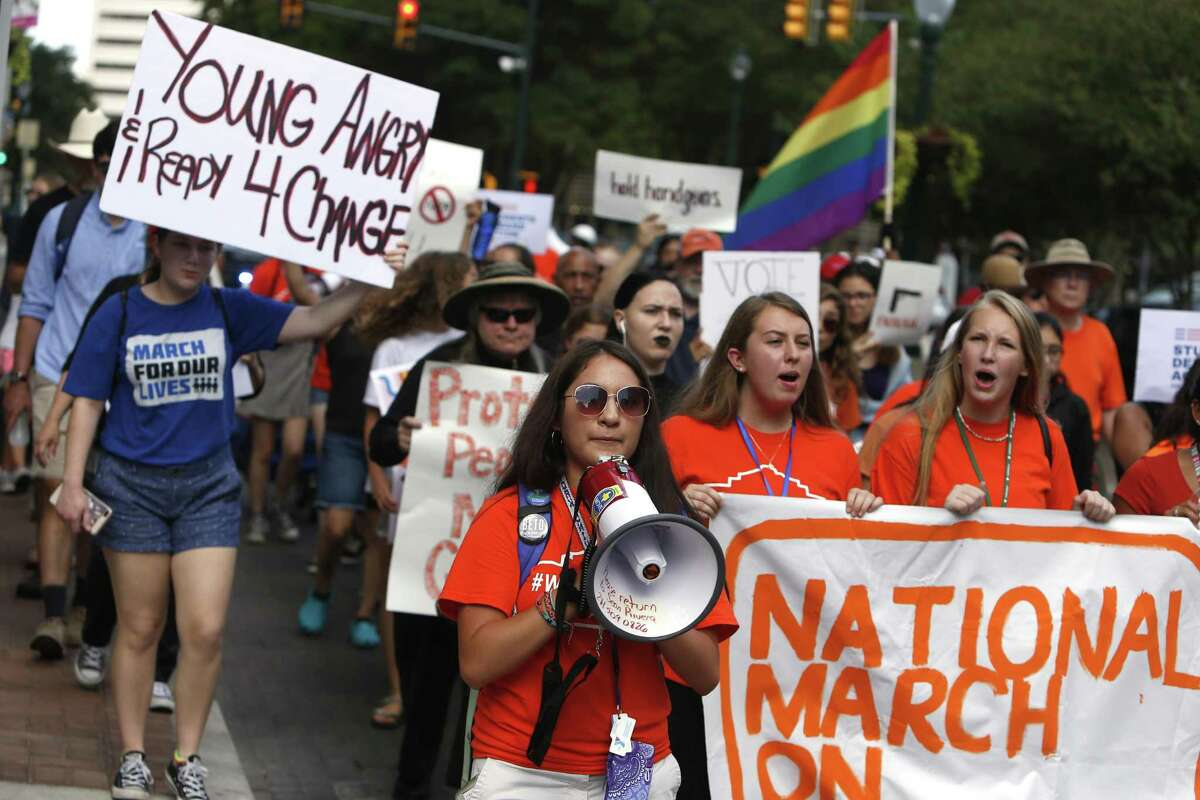 Marchers head toward Houston street where they will make two stops. Students will be marching downtown as part of the