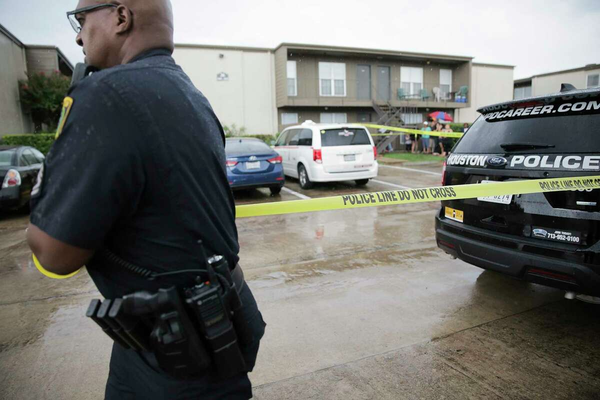 Houston Police Dept. put out a police tape in the apartment complex where two young children's bodies were found in their father's apartment on Saturday, Aug. 4, 2018 in Houston. Jean Pierre Ndossoka was charged with capital murder in the deaths.