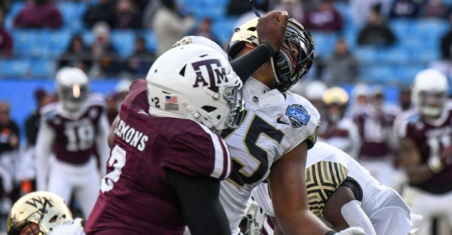 CHARLOTTE, NC - DECEMBER 29: Texas A&M Aggies defensive lineman Micheal Clemons (2) fights through a block by Wake Forest Demon Deacons offensive lineman Justin Herron (75) during the Belk Bowl between the Wake Forest Demon Deacons and the Texas A&M Aggies on December 29, 2017 at Bank of America Stadium in Charlotte, NC. (Photo by William Howard/Icon Sportswire via Getty Images) Photo: Icon Sportswire/Icon Sportswire Via Getty Images