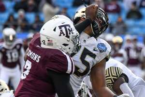 CHARLOTTE, NC - DECEMBER 29: Texas A&M Aggies defensive lineman Micheal Clemons (2) fights through a block by Wake Forest Demon Deacons offensive lineman Justin Herron (75) during the Belk Bowl between the Wake Forest Demon Deacons and the Texas A&M Aggies on December 29, 2017 at Bank of America Stadium in Charlotte, NC. (Photo by William Howard/Icon Sportswire via Getty Images)