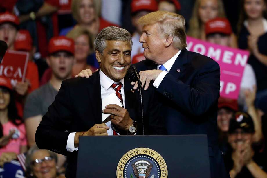 In this Aug. 2, 2018, photo, President Donald Trump, right, greets Senate candidate Rep. Lou Barletta, R-Pa., during a rally in Wilkes-Barre, Pa. More than 2,600 candidates are running in the midterm elections. But for the president, the election comes down to one person: Donald Trump. With the primary calendar winding down, Trump's me-first strategy is prompting a wave of concern within his own party. (AP Photo/Matt Rourke) Photo: Matt Rourke / Copyright 2018 The Associated Press. All rights reserved.
