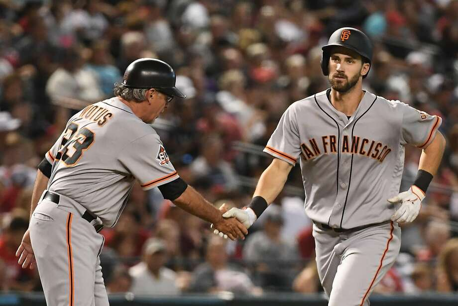 Steven Duggar #6 of the San Francisco Giants isis congratulated by third base coach Ron Wotus after hitting a solo homer in the fourth inning. Photo: Jennifer Stewart / Getty Images
