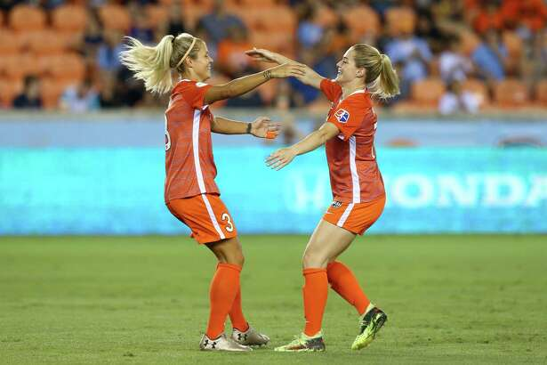 Dash defender Rachel Daly, left, is congratulated by forward Kealia Ohai after scoring a goal against the Orlando Pride during a match July 11 at BBVA Compass Stadium.
