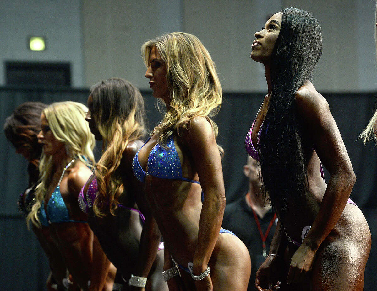Women compete during the Global Championships PRO/AM & Fitness Expo at the Beaumont Civic Center. Amateur and professional bodybuilders competed in the Global Bodybuilding Organization's event, which included beach body, swag and bodybuilding divisions. Health and fitness vendors lined the arena, and other fitness competitions and demonstrations, including Jiu Jitsu and powerlifting events were held in conjunction with the GBO contests. Saturday, August 4, 2018 Kim Brent/The Enterprise