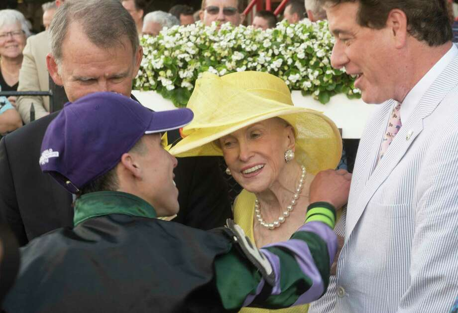 Jockey Irad Ortiz Jr. gives Mary Lou Whitney a hug after winning 91st running of The Whitney Stakes as John Hendrickson looks on Saturday Aug. 4, 2018 in Saratoga Springs, N.Y.(Skip Dickstein/Times Union) Photo: SKIP DICKSTEIN