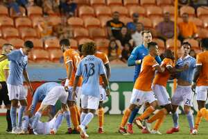 Sporting Kansas City defender Amer Didic (2) goes after Houston Dynamo forward Alberth Elis (17) during foul in the second half of an MLS match at BBVA Compass Stadium Saturday, Aug. 4, 2018, in Houston.