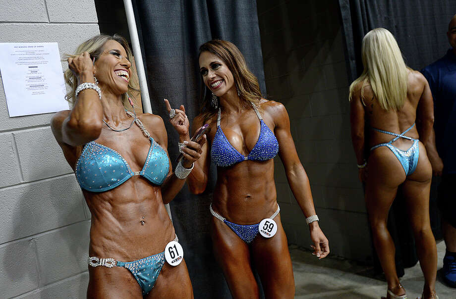 Dr. Elsie Garcia (left) and Angelica Barrilleaux joke behind the scenes during the Global Championships PRO/AM & Fitness Expo at the Beaumont Civic Center. Amateur and professional bodybuilders competed in the Global Bodybuilding Organization's event, which included beach body, swag and bodybuilding divisions. Health and fitness vendors lined the arena, and other fitness competitions and demonstrations, including Jiu Jitsu and powerlifting events were held in conjunction with the GBO contests. Saturday, August 4, 2018 Kim Brent/The Enterprise Photo: Kim Brent/The Enterprise