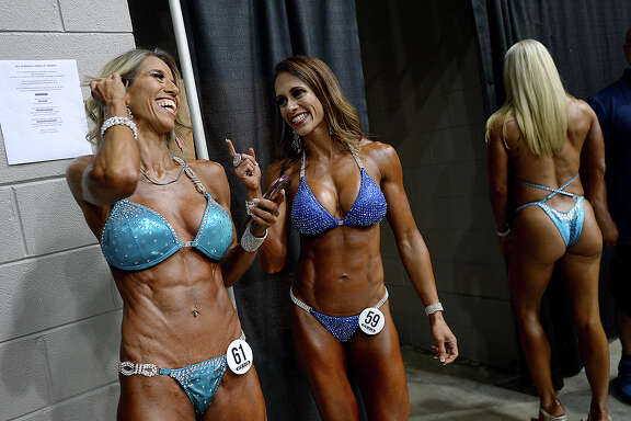 Dr. Elsie Garcia (left) and Angelica Barrilleaux joke behind the scenes during the Global Championships PRO/AM & Fitness Expo at the Beaumont Civic Center. Amateur and professional bodybuilders competed in the Global Bodybuilding Organization's event, which included beach body, swag and bodybuilding divisions. Health and fitness vendors lined the arena, and other fitness competitions and demonstrations, including Jiu Jitsu and powerlifting events were held in conjunction with the GBO contests. Saturday, August 4, 2018 Kim Brent/The Enterprise