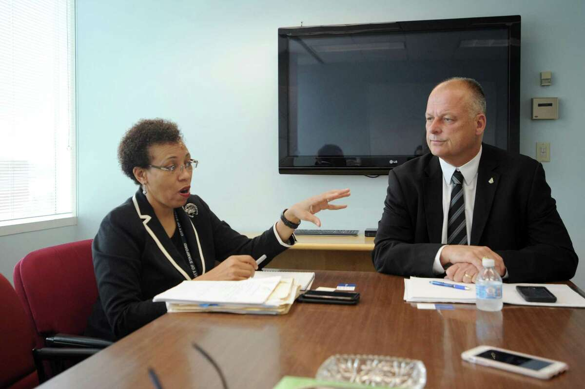 The Director of Health Dr. Jennifer Calder, left, and Director of Public Safety, Health and Welfare Ted Jankowski speak about the Stamford Citizen Services Corp. program inside Government Center in downtown Stamford, Conn. on Wednesday, Aug. 1, 2018.