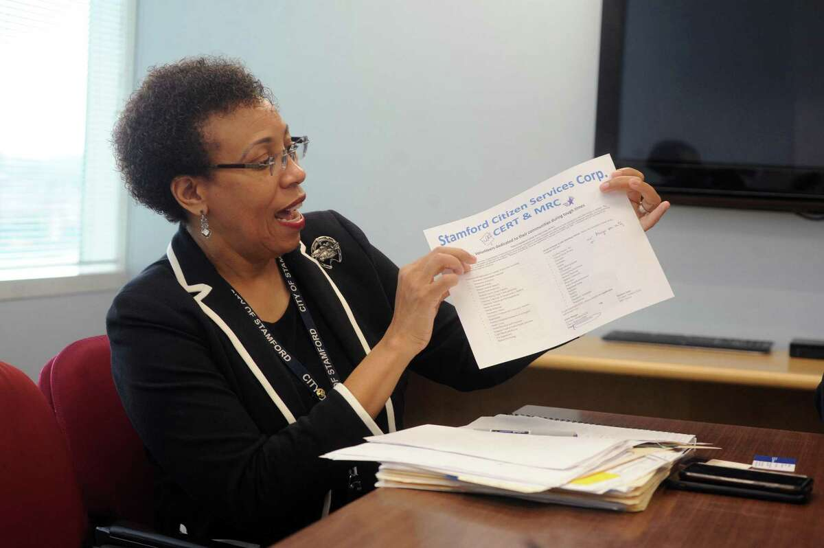 The Director of Health for the city of Stamford Dr. Jennifer Calder holds up a list of the various volunteer skills needed for the Stamford Citizen Services Corp. program inside Government Center in downtown Stamford, Conn. on Wednesday, Aug. 1, 2018.