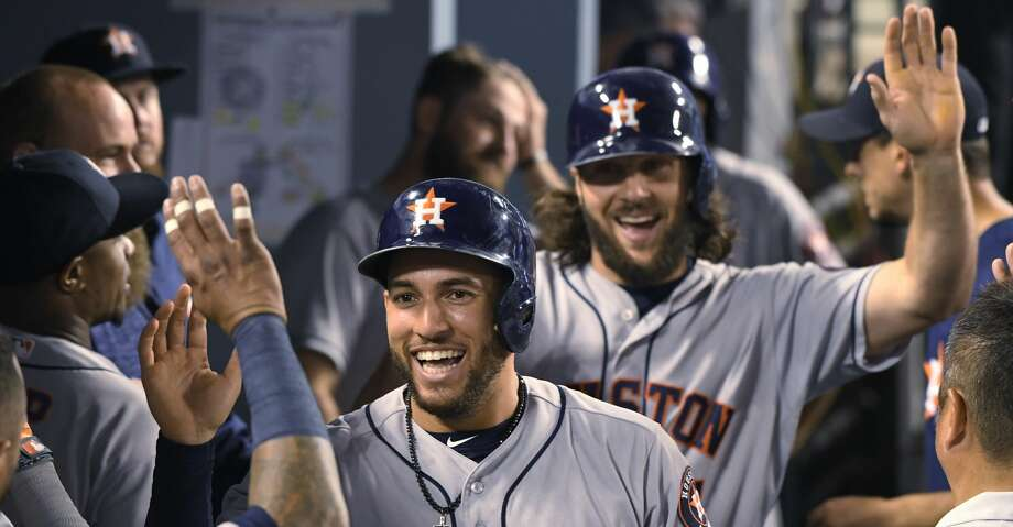 Houston Astros' George Springer, front center, and Jake Marisnick are congratulated after scoring on a home run by Josh Reddick during the eighth inning of a baseball against the Los Angeles Dodgers game Saturday, Aug. 4, 2018, in Los Angeles. (AP Photo/John McCoy) Photo: John McCoy/Associated Press