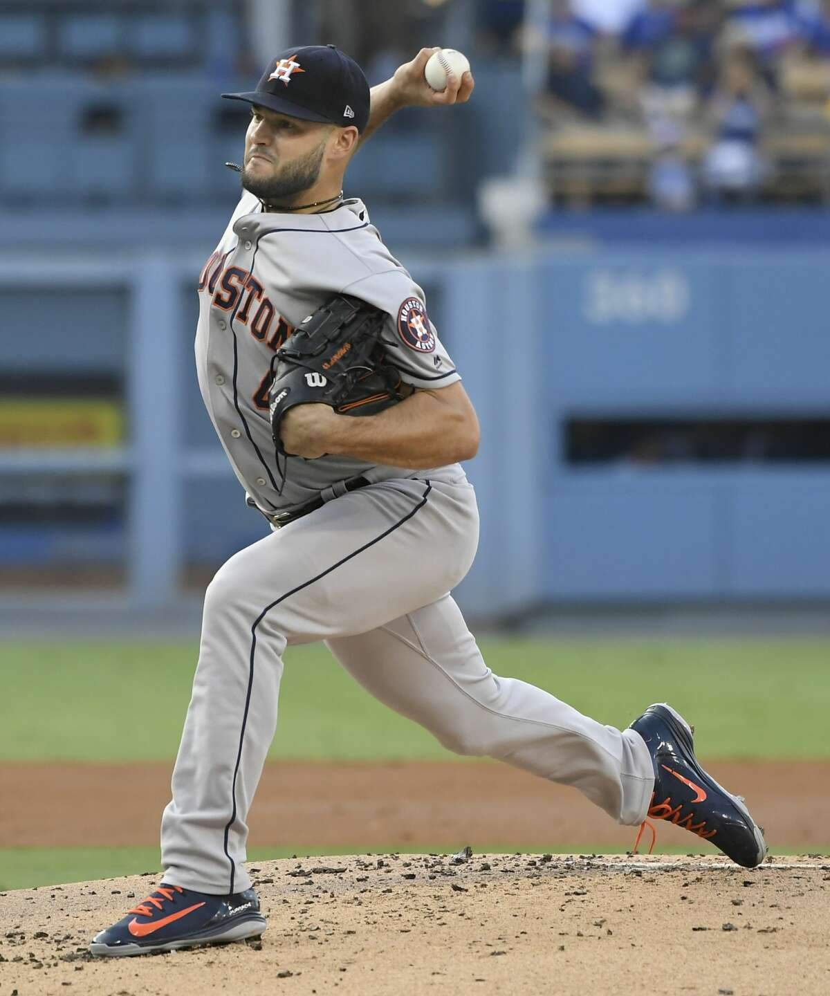 Houston Astros starting pitcher Lance McCullers Jr. throws against the Los Angeles Dodgers during the second inning of a baseball game Saturday, Aug. 4, 2018, in Los Angeles. (AP Photo/John McCoy)