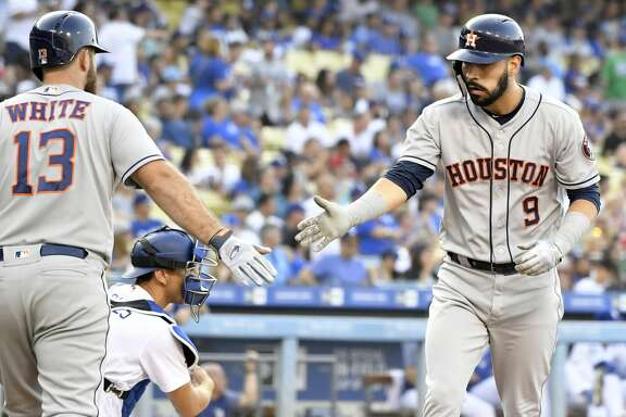 Houston Astros' Tyler White, left, congratulates Marwin Gonzalez, right, on his home run against the Los Angeles Dodgers during the second inning of a baseball game Saturday, Aug. 4, 2018, in Los Angeles. (AP Photo/John McCoy)