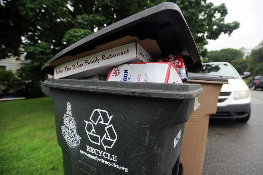 A full recycling bin sits on Cady St. in Stamford, Conn. on Wednesday, Aug. 1, 2018. Photo: Michael Cummo / Hearst Connecticut Media / Stamford Advocate