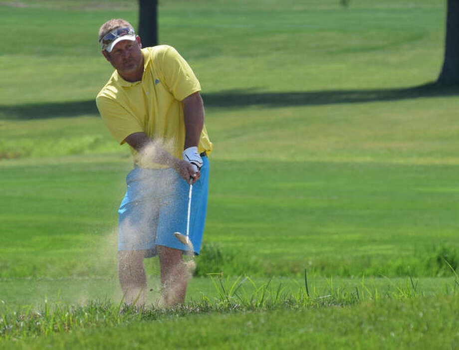 Mike Barnes hits his ball out of the sand trap Saturday at the Links during the Jacksonville City Golf Tournament. Photo:       Audrey Clayton | Journal-Courier