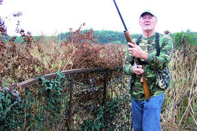 Sunflower fields are among the top locations for dove hunting. Above, former St. Louis Cardinals and Dallas Cowboys Hall of Famer Jackie Smith hunts dove in an area sunflower field last year. The opening of dove season is approaching quickly.