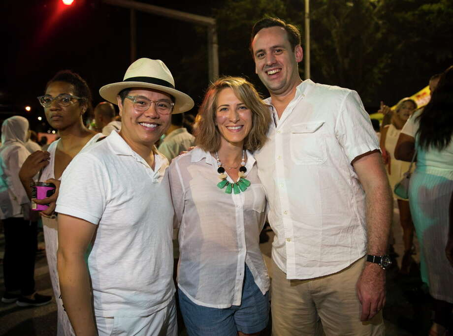 Vladimir de la Cruz, Chrystan Skefos and Josh Leasure during White Linen Night in the Heights on Saturday, Aug. 4, 2018 in Houston. Photo: Annie Mulligan, Houston Chronicle / © 2018 Annie Mulligan / Houston Chronicle