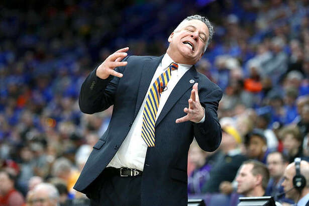 At Auburn, twice-penalized head coach Bruce Pearl (above) appears untouched with a Top 10 team, even though Auburn assistant coach Chuck Person was indicted and fired and faces trial in February.